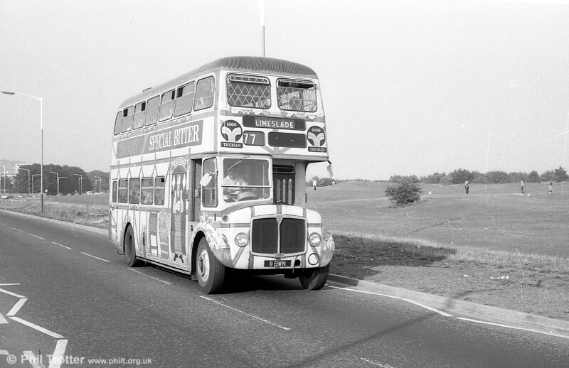 In 1972, 1962-built AEC Regent V/Willowbrook H39/32F 571 (11 BWN) was repainted in an overall advertisement for Truman's Beers, as seen here on Mumbles Road on 28th July 1973.