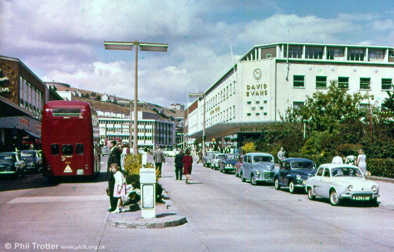 A commercial view of Princess Way, Swansea showing the rear of AEC Renown/Park Royal H39/32F 1245 (308 ECY).