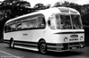 """<DIV ALIGN=left>Immaculately turned out AEC Reliance/Weymann C37F 1035 (PWN 66), one of the last batch of five 'Fanfares' delivered in 1958. Back in the spring of 1956, SWT launched a Swansea 'Town Tour' which gave residents and visitors the opportunity to """"see the sights"""".  The comprehensive itinerary included views across Swansea Bay from Townhill and Mayhill plus a visit to Swansea Docks, which of course was much busier then.  The tour ran twice daily on Mondays to Fridays, leaving Oystermouth at 9.45am and 6.15pm, picking up also in the town centre. Places of interest en route were pointed out by a qualified tour guide. Using the company's then brand new Weymann Fanfare coaches, each tour covered about 40 miles, lasted about two and a half hours and cost a mere 3/3d – or about 17p in today's money!</DIV>"""
