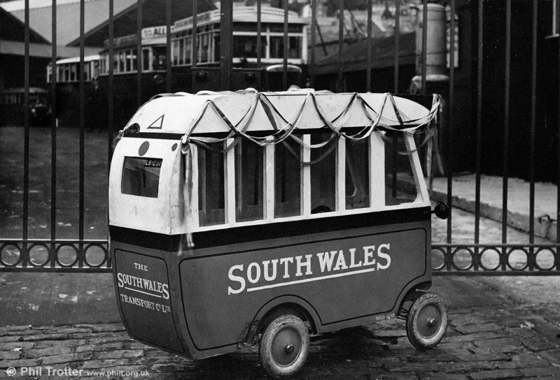 In the days before more sophisticated media it was commonplace for coach operators to use model vehicles for promotions at special events. However, it is what is on offer behind the gates of Brunswick Street depot which provides more interest!