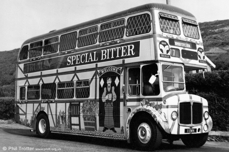 In 1972, 1962-built AEC Regent V/Willowbrook H39/32F 571 (11 BWN) was repainted in an overall advertisement for Truman's Beers, as seen here at Limeslade.