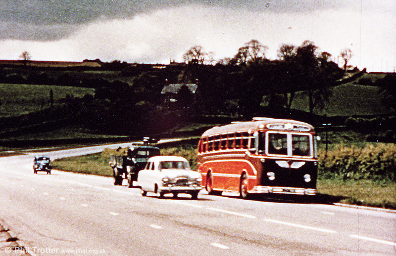 The A48 with hardly any traffic! A Neath & Cardiff Luxury Coaches Guy Arab LUF /Park Royal C41C heads for Cardiff. N&C had 12 of these unusual vehicles delivered in 1954/5.