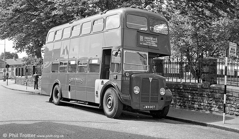 Tin front AEC Regent III/Weymann L20/26R 1180 (JWN 907) waits to depart from St. Mary's Square Swansea, on the lengthy service 18 to Ammanford via GCG.