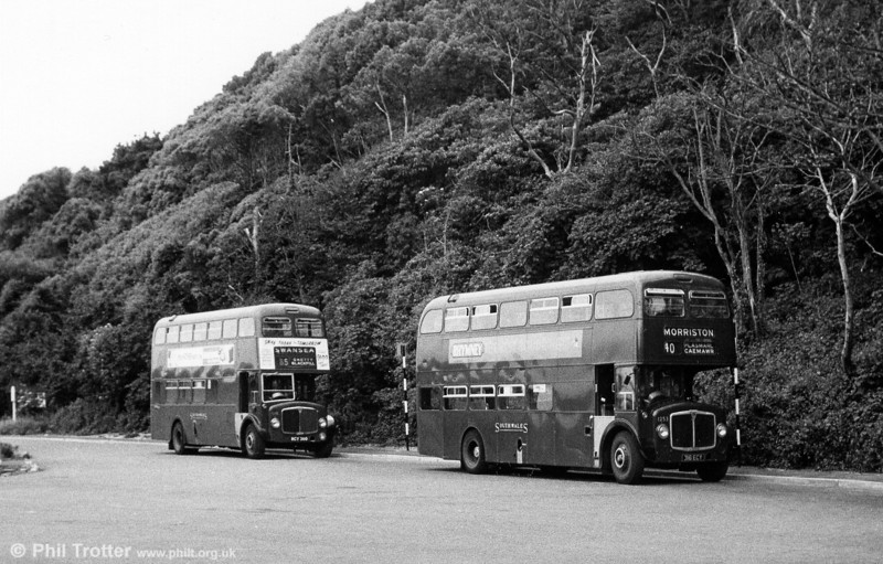 A gloomy day at Caswell Bay finds very little custom for AEC Renown/Park Royal H39/32F 1253 (316 ECY) and AEC Regent V/Weymann H39/32F 518 (RCY 360).