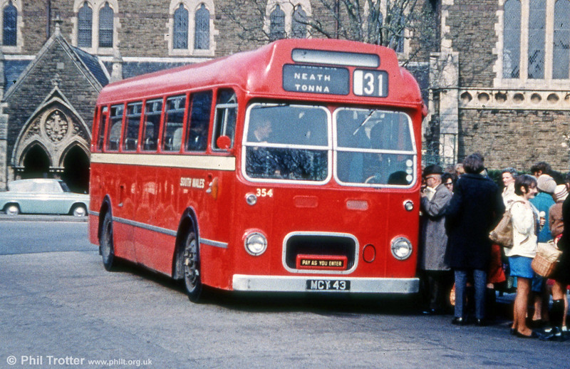 With its ungainly off-centre grille, 354 (MCY 43) was a 1956 Bristol LS6g/ECW B45F seen at Neath on route 31; it's unlikely that all those people would be heading for the final destination - Pont-Neath-Vaughan!