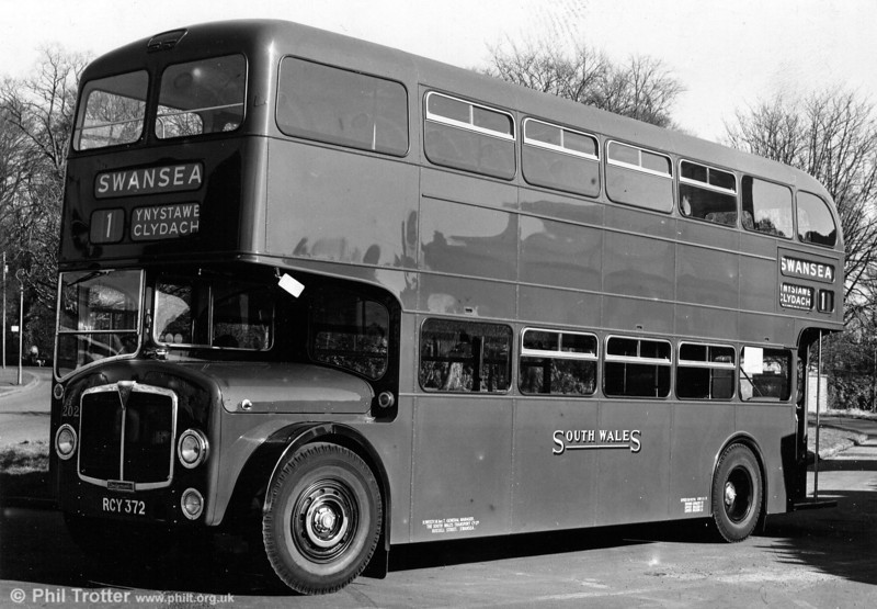 <DIV ALIGN=left>When, in 1956, AEC began to trial a new low-floor, low-height double decker – named the Bridgemaster – it was almost to be expected that SWT would take one on trial.  In fact, the third prototype, registered 60 MMD, was finished in SWT livery and, having toured other operators around the country, eventually was absorbed into the SWT fleet as number 1213. This unique vehicle had a Crossley body and many detail differences from the fleet of 22 'standard' Bridgemasters which SWT subsequently purchased. The type became quite popular amongst enthusiasts, if not always drivers, and for those who lived on the Tycoch and Brynmill to Port Tennant to Grenfell Park services (33, 35, 75 and 76) the Bridgemasters were an everyday sight. They even strayed as far as Neath and Aberavon Beach on services which also required low-height vehicles because of low bridges at St. Thomas. The first batch, numbered 1199-1207 were of the rear entrance design and were built in 1959. All previous 'low bridge' buses had consisted of a sunken upper deck gangway and bench seats in order to keep the vehicle height down. Seen when new is 1959 AEC Bridgemaster/Park Royal H41/31R 1202 (RCY 372). I travelled back and fore to school on these day in, day out for several years but took no photographs. Unbelievable!</DIV>