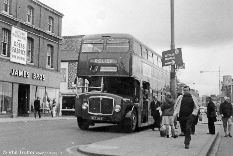 AEC Bridgemaster/Park Royal H43/29F 1208 (WCY 888) at High Street, Swansea. Unusually, the bus is on route 77 (Morriston to Mumbles) which very rarely saw Bridgemasters. Possibly the bus is a substitute for a failed Regent V; the weather looks a little chilly for it to be a summer duplicate.