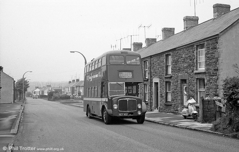 AEC Regent V/Weymann H32/28R 471 (NCY 462) on Carmarthen Road, Fforestfach.  This view had hardly changed today, except that the land behind the row of terraced houses is now dominated by Parc Fforestfach shopping centre.