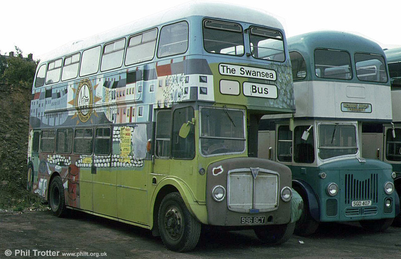 AEC Regent V/Willowbrook H39/32F 561 (996 BCY) at the premises of Morris Bros., Swansea. It had been used as a promotional vehicle by Swansea City Council.