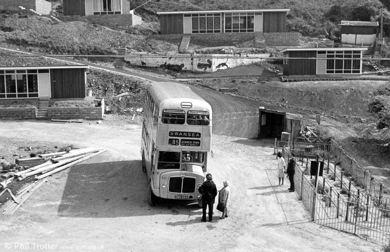 "<div align=""left"">Unpainted AEC Regent V/Weymann H39/32F 531 (SWN 994) amongst the chalets at the upper (winter) terminus at Caswell Bay. The unpainted buses were: 1958 AEC Regent V LD3RAs with Weymann 71-seat bodywork, 504 RCY 346; 508 RCY 350; 511 RCY 353; 516 RCY 358; 519 RCY 361; 526 RCY 368. 1959 AEC Regent V 2D3RAs with Weymann 71-seat bodywork: 527-533 SWN 990 - 996.</div>"