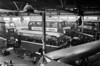 A view overlooking the Ravenhill workshops with a variety of AEC vehicles - including MkI, MkII and MkIII Regents - undergoing maintenance.
