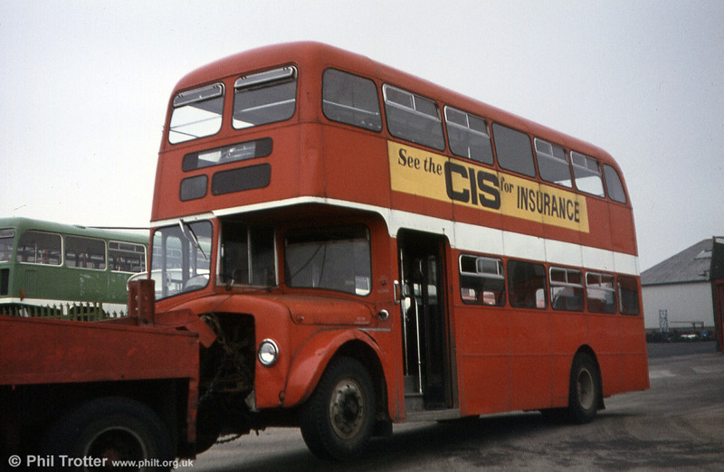 854 (437 HCY), a 1964 AEC Regent V 2D3RA/Willowbrook H39/32F is towed away from Ravenhill. During its time with SWT, 854 (running as 604) had in 1968 sported an experimental livery based on BET red with ivory window surrounds.