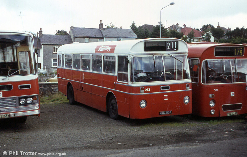 Seen here in store at Haverfordwest following withdrawal is 213 (KKG 213F), an AEC Reliance/Marshall DP41F acquired from Western Welsh.