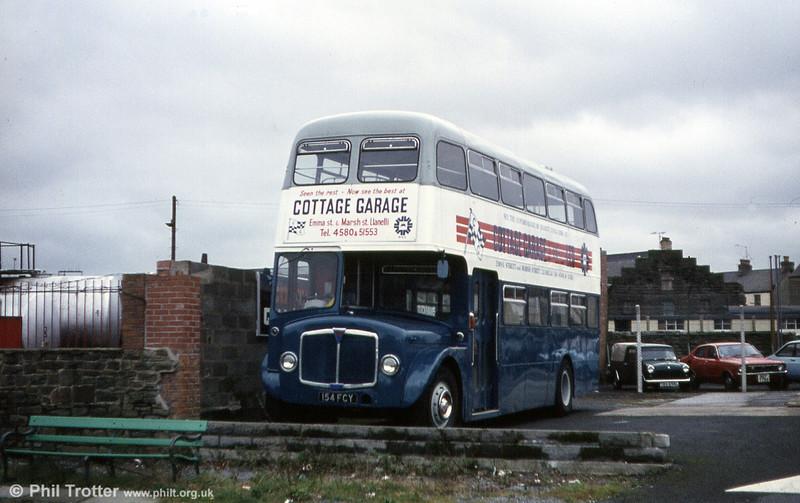 AEC Regent V/Willowbrook H39/32F 586 (154 FCY) with Cottage Garage, Llanelli.