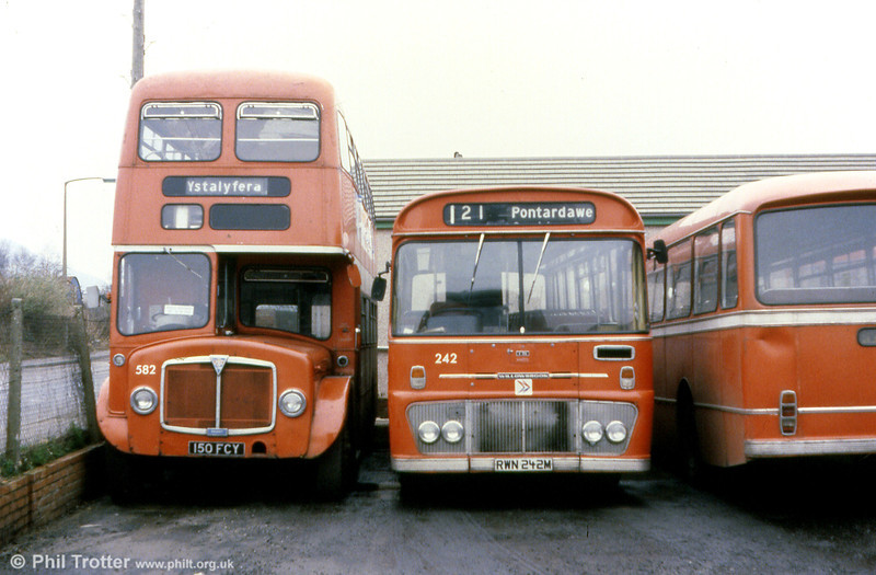 Two contrasting Willowbrook products: AEC Regent V with H39/32F 582 (150 FCY) and Ford R1014 242 (RWN 242M) with B45F.