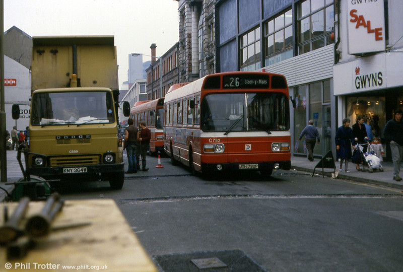 A pair of Leyland Nationals led by 782 (JTH 782P) negotiate roadworks in Ocford Street. The truck illustrates probably Swansea Council's least attractive vehicle livery...