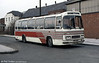 Leyland Leopard/Duple C49F 164 (NCY 472R) in local coach livery, on National Express work at Burton on Trent in February 1984.