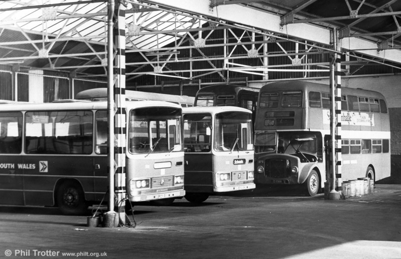 Withdrawn AEC Regent Vs/Willowbrook H39/32F 575 (15 BWN) in the company of two Bedford DPs at Gorseinon.