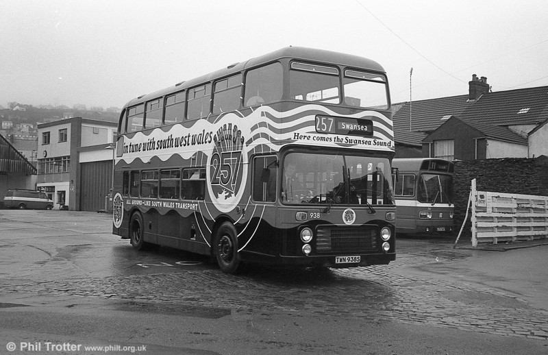 In March 1981, Bristol VRT 938 (TWN 938S) was repainted in an all-over advertisement for Swansea Sound, the local commercial radio station. The bus is seen leaving Brunswick Street on March 7th, ready for an 'inaugural ceremony.