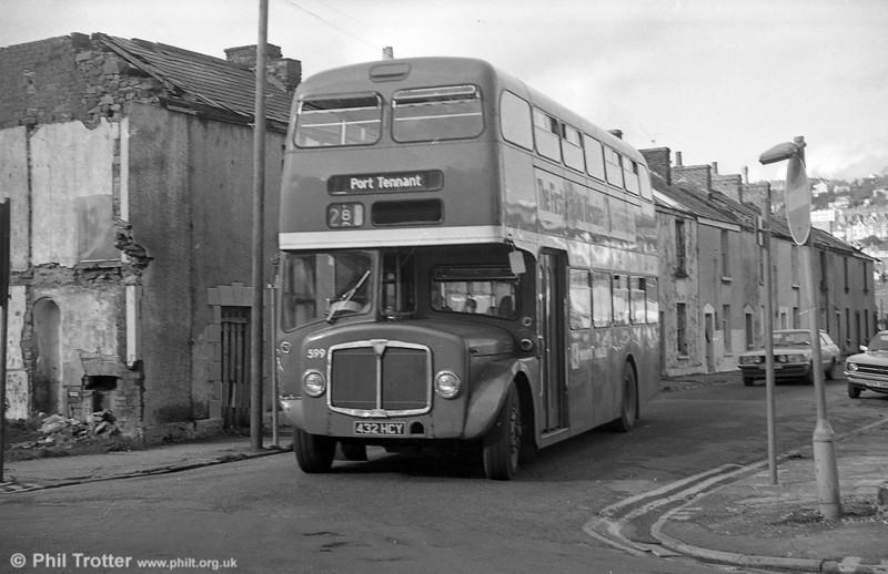 1964 AEC Regent V/Park Royal H39/32F 599 (432 HCY) and building demolition at Swansea.