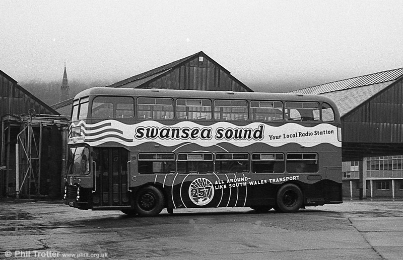 In March 1981, Bristol VRT 938 (TWN 938S) was repainted in an all-over advertisement for Swansea Sound, the local commercial radio station. The bus is seen at Brunswick Street on March 7th, ready for an 'inaugural ceremony.