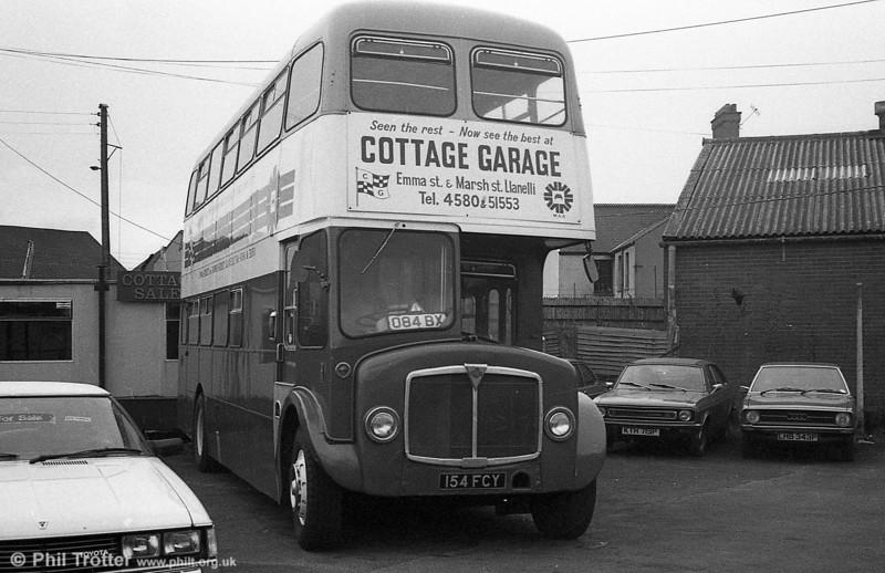 The now preserved AEC Regent V/Willowbrook H39/32F 586 (154 FCY) at Cottage Garage, Llanelli.