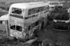AEC Regent V/Willowbrook H39/32F 561 (996 BCY) in derelict condition at the premises of Morris Bros., Swansea. It had previously been used as a promotional vehicle by Swansea City Council.