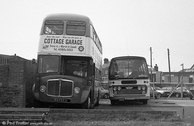 AEC Regent V/Willowbrook H39/32F 586 (154 FCY) with AEC Reliance/Plaxton C44F 177 (XCY 177J) at Cottage Garage, Llanelli.