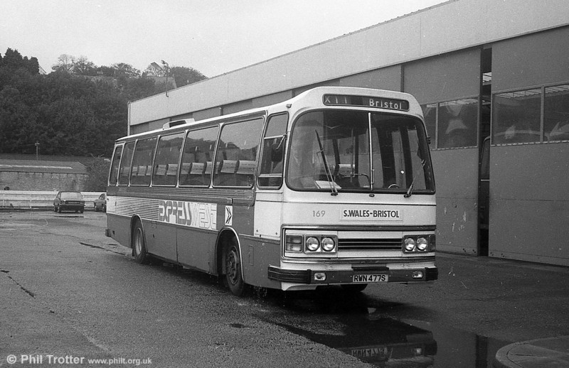 The 'Expresswest' services were introduced from 19th September 1981, following the opening of the M4 Pyle – Port Talbot section the previous day. Service X10 operated Carmarthen – Bristol via Llanelli, Swansea, Port Talbot, Cardiff and Newport; X11 Haverfordwest – Bristol via Narberth, Carmarthen, Swansea, Cardiff and Newport and X12 Haverfordwest – Bristol via Pembroke, Tenby, Carmarthen, Swansea, Cardiff and Newport. The services were operated jointly by SWT (8 vehicles), National Welsh (2 vehicles) and Bristol Omnibus (1 vehicle). Coaches used on the service carried a distinctive 'Expresswest' (red, white and blue) livery. The 'Expresswest' logo was also used on bus stops, publicity material and drivers' badges and ties. One of the first vehicles to carry the new livery was SWT Leopard/Duple DP49F 169 (RWN 477S).