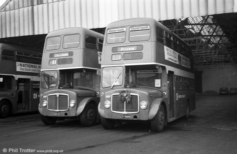 An AEC Regent V 'Farewell' tour, organised by the Railway Club of Wales, ran on December 19th 1981. AEC Regent V/Willowbrook H37/27F 869 (CCY 989C) carried a wreath for the occasion and is seen here at Brunswick St. with 881.