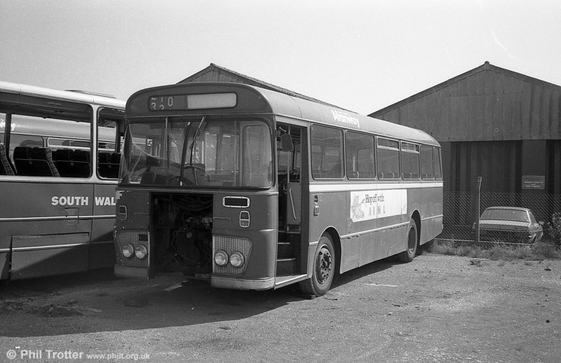Ford R1014/Willowbrook B45F 254 (TCY 254N) at Port Talbot.