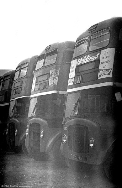 1964 AEC Regent V/Weymann H39/32F 592 (425 HCY) and others at Port Talbot after withdrawal.