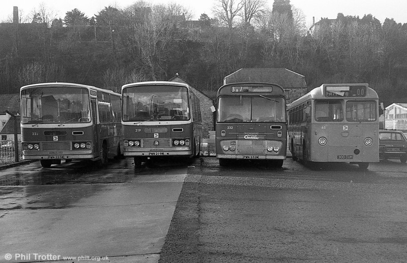 Bedford YRQ/Willowbrook DP45F 223/19 (PWN 223/19M), Ford R1014/Willowbrook B45F 232 (PWN 232M) and Leyland Tiger Cub/Marshall B45F towing bus 65 (300 CUH) at Haverfordwest.