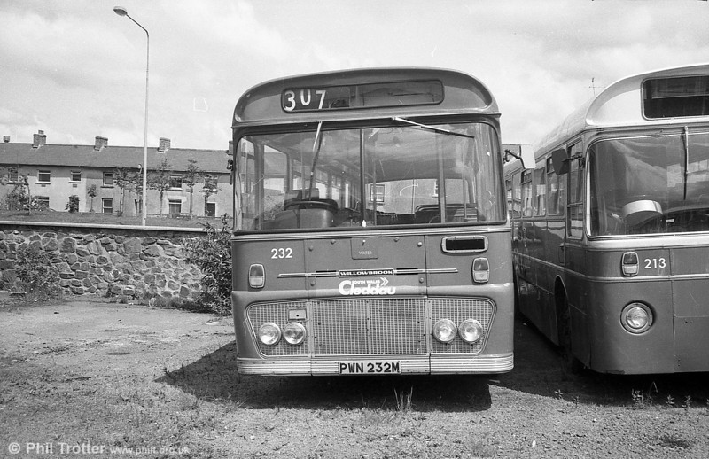 Ford R1014/Willowbrook B45F 232 (PWN 232M) in store at Haverfordwest.