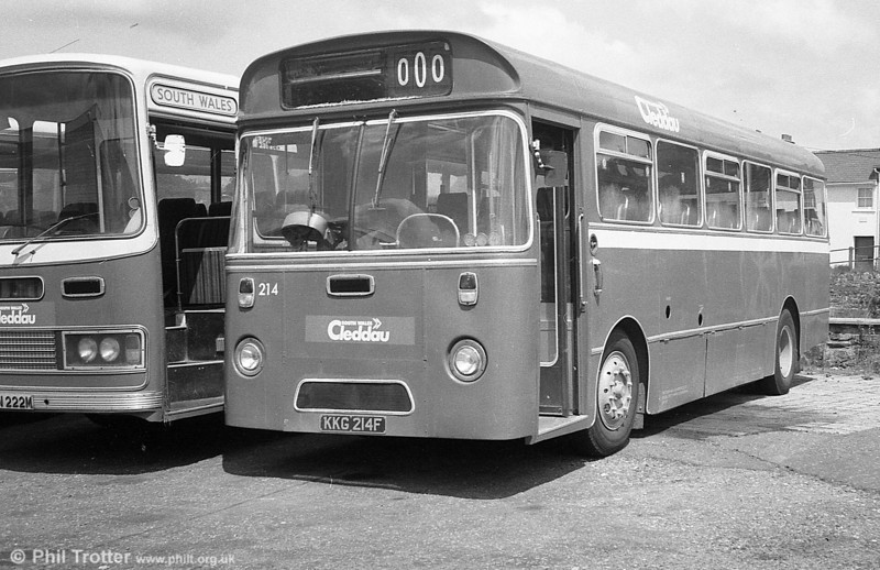 AEC Reliance/Marshall DP41F 214 (KKG 214F), ex-Western Welsh, in store at Haverfordwest. <br /> Other withdrawn vehicles still in store at Haverfordwest during June 1981 included: 213/4 (KKG 213/4F) AEC Reliances/Marshall DP41F; 219/22-4 (PWN 219M etc.), Bedford YRQ/Willowbrook DP45F; 232 (PWN 232M) a Ford R1014/Willowbrook B45F and 855 (438 HCY) an AEC Regent V/Willowbrook H39/32F).