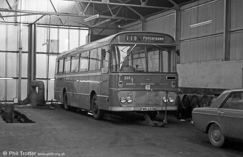 Ford R1014/Willowbrook B45F 235 (PWN 235M) in Ammanford depot.