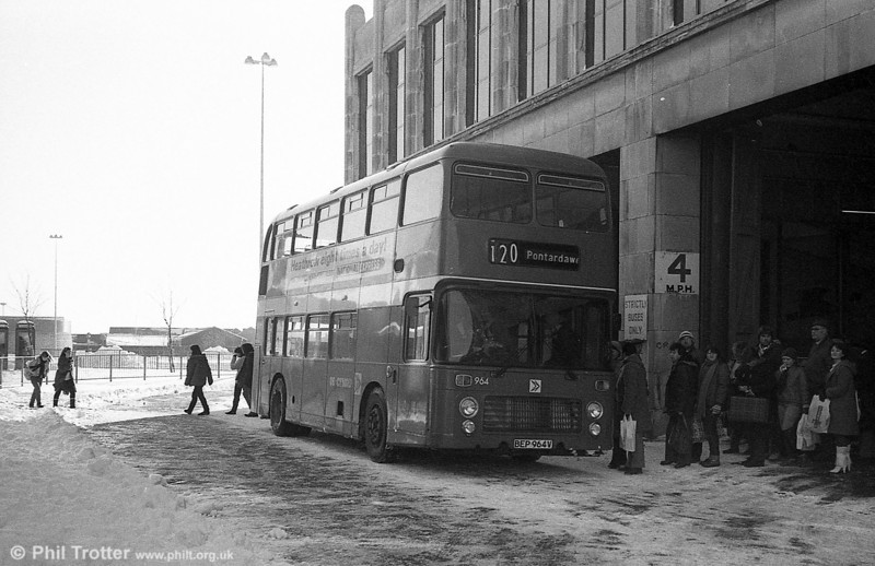 The arctic weather of January 8/9 1982 led to a suspension of services over that weekend. A limited operation was put on from January 11 using only a dozen vehicles which departed from the former United Welsh Coach Station in Swansea. The Quadrant Bus Station reopened on 13th January. VRT 964 prepares to leave for Pontardawe.