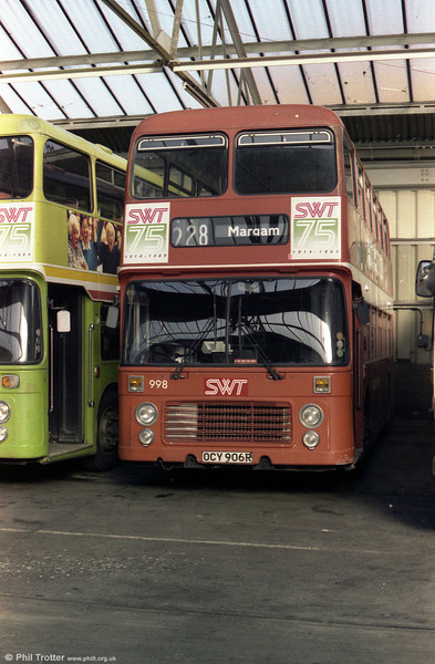 Still in red livery, 998 (OCY 906R) was a 1977 VRT rebodied after a fire in 1981 and renumbered to make way for the Olympians.