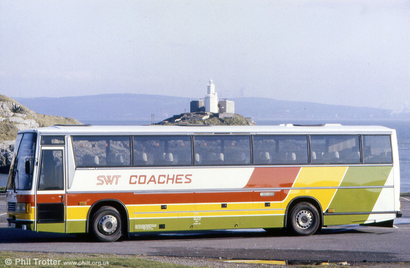 SWT 122 (MKH 68A), one of the reliveried Leyland Tigers/Duple Carribean C46FT poses at Bracelet Bay, Mumbles in its newly applied livery.