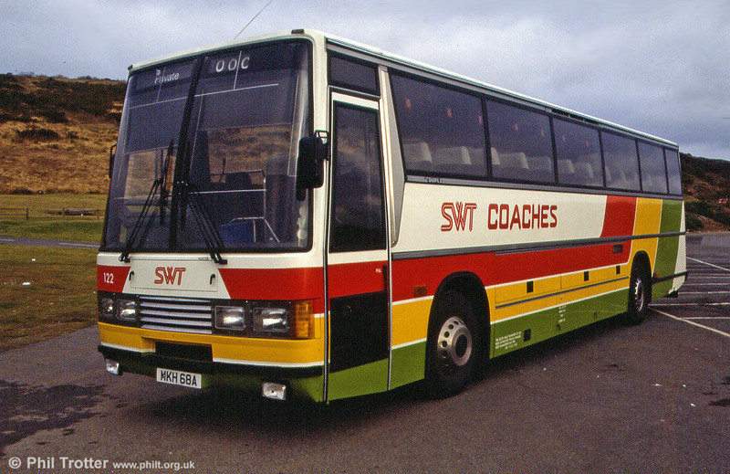 SWT 122 (MKH 68A), a 1984 Leyland Tiger/Duple Caribbean C46FT, originally delivered in National Express livery and registered A122 XEP.
