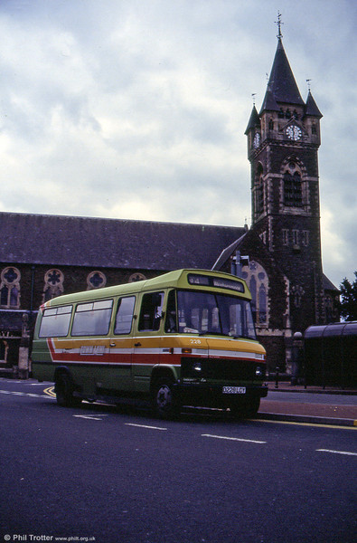 The familiar tower of St David's Church, Neath (built in 1866) forms a backdrop to L608D no. 228 waiting at Victoria Gardens.