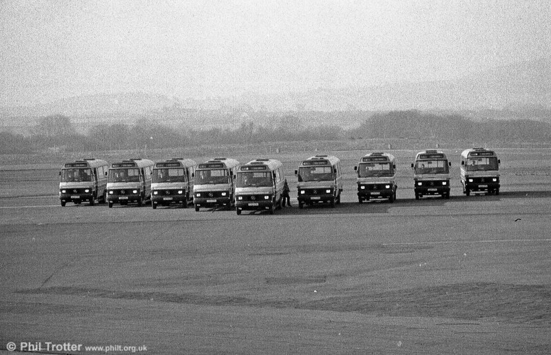It's February 1986 and the first batch of SWT minibuses - part of an initial batch of fifteen Mercedes L608Ds are shown to the media 'flying' in formation at Swansea Airport.