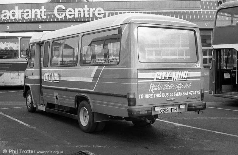 A rear view of 213 as it sits at the Quadrant Bus Station, illustrating the strong local identity applied to these vehicles and at the time a world away from corporate National Bus livery.