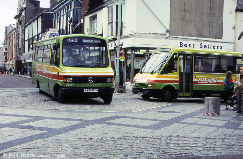 330 and MCW 256 meet in Oxford Street, Swansea.