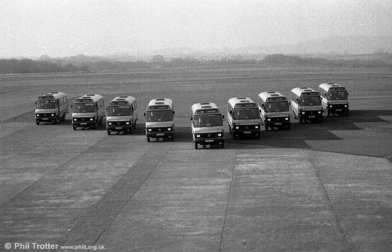 A second view of nine Mercedes L608Ds on the runway at Swansea Airport in February 1986.