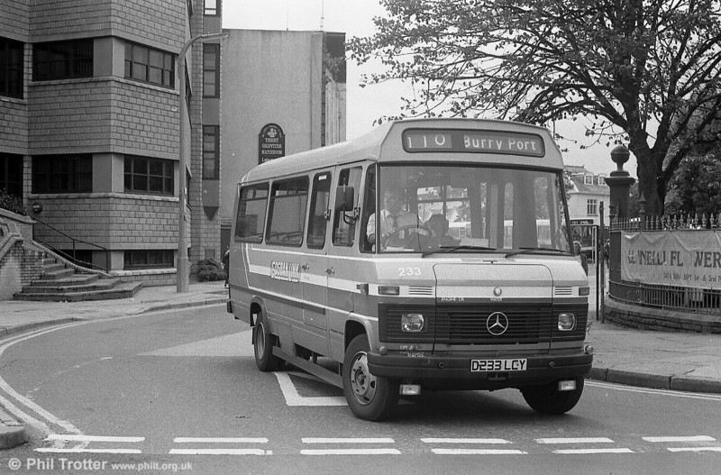 233 leaves the erstwhile Llanelli Town Hall Bus Station.