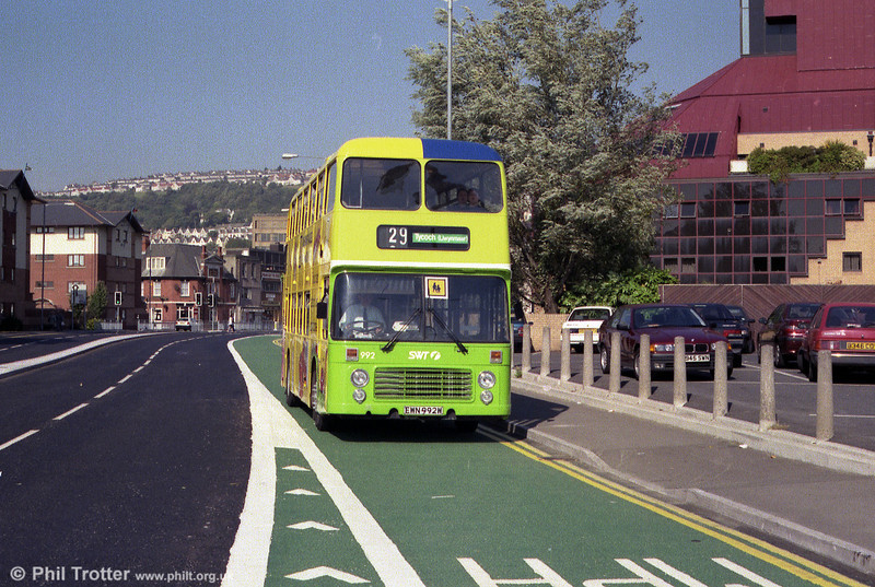 Carrying an overall advert for Yellow Pages but retaining fleet livery on the front is VRT 992 (EWN 992W).