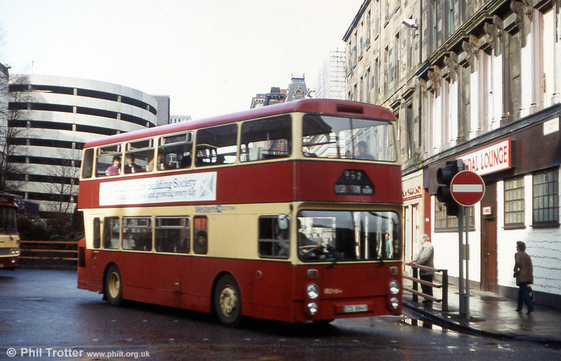 Western Scottish R2884 (ECS 884V), a Daimler Fleetline/Northern Counties H44/31F leaving Glasgow Anderston Cross Bus Station in 1983.
