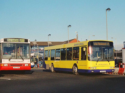 Barnsley & District 245 (T545AUA), in yellow and purple, is an ex Keighley & District Wright bodied Volvo B10BLE.