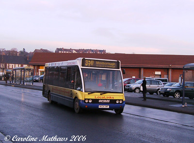 Doncaster Community Transport was using Local Links liveried Optare Solo MX04 VMF, seen on Hartley Street, 28th December 2006.